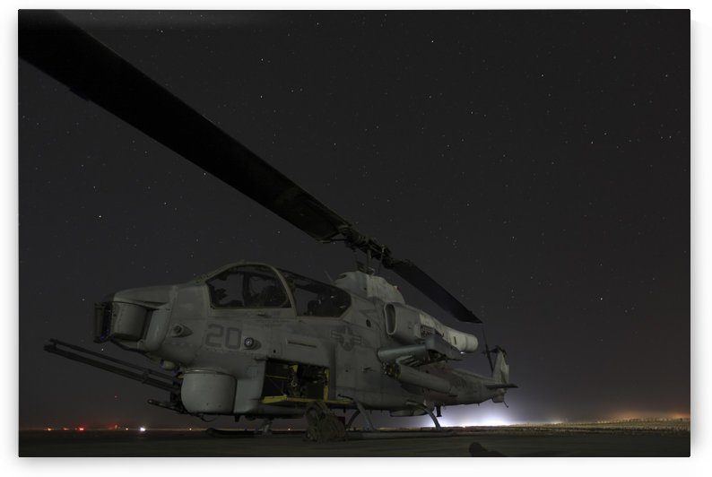 A U.S. Marine Corps AH-1W Cobra attack helicopter. by StocktrekImages