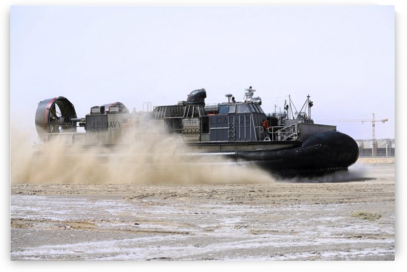 An air-cushion landing craft approaches the shore of Camp Al-Galail Qatar. by StocktrekImages