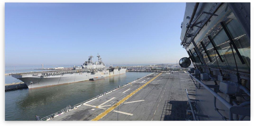 USS Kearsarge and USS Bataan moored. by StocktrekImages