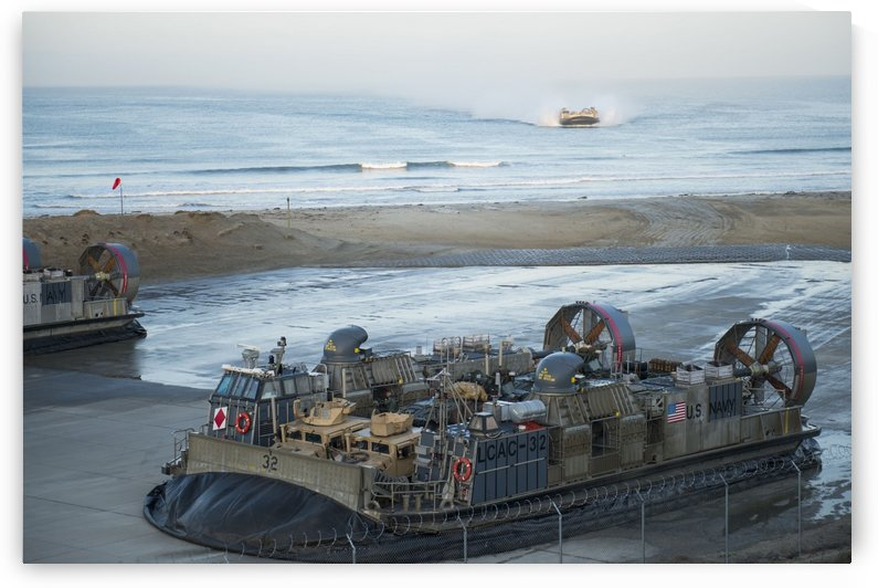 Landing Craft Air Cushions return to their homeport. by StocktrekImages