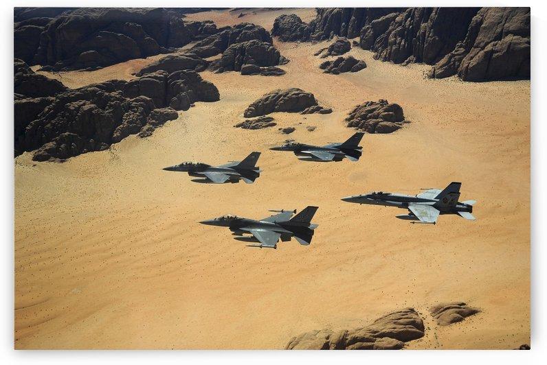 Military planes flying over the Wadi Rum desert in Jordan. by StocktrekImages