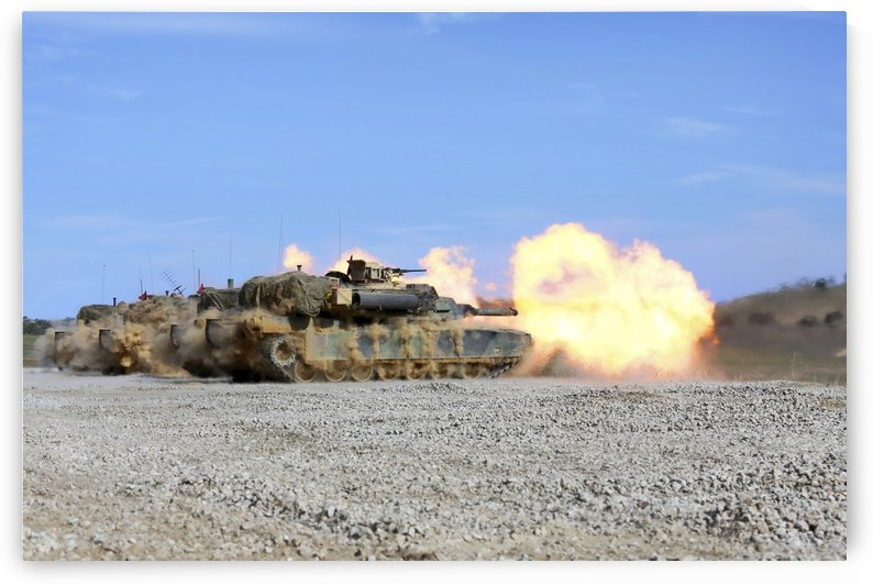 M1A1 Abrams fire their 120mm smoothbore cannon. by StocktrekImages