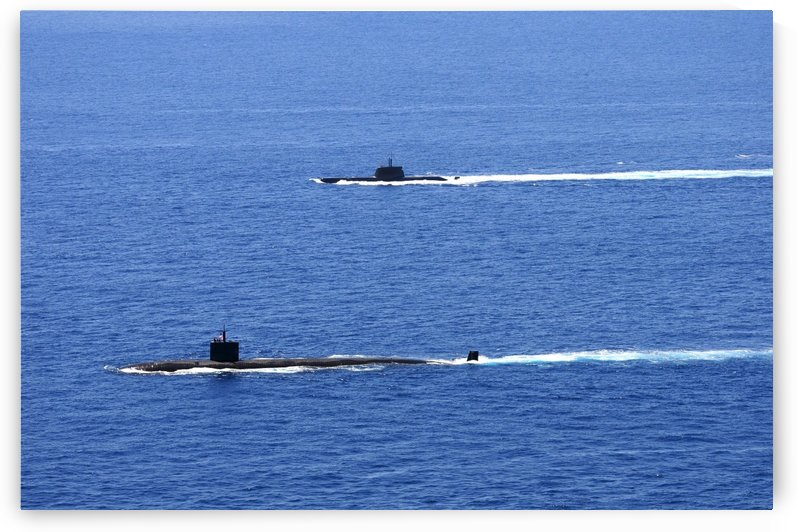 Attack submarine USS Alexandria alongside Brazilian submarine BNS Tikuna. by StocktrekImages