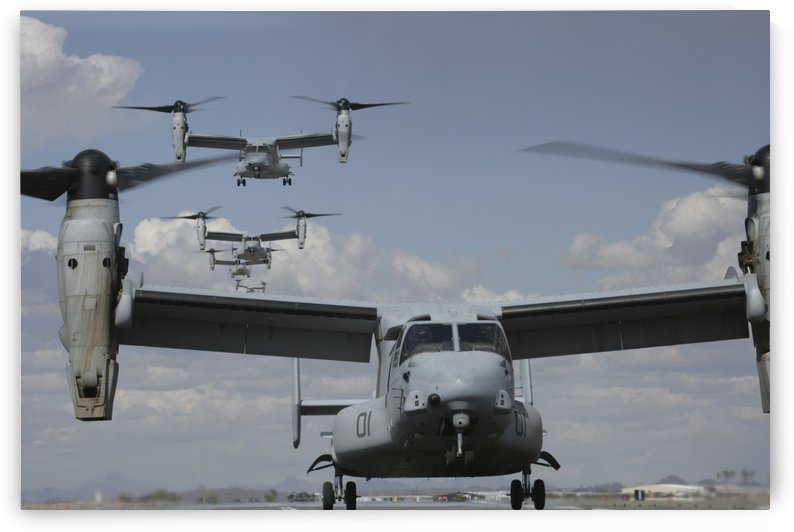 U.S. Marine Corps MV-22 Osprey tiltrotor aircraft prepare for landing. by StocktrekImages