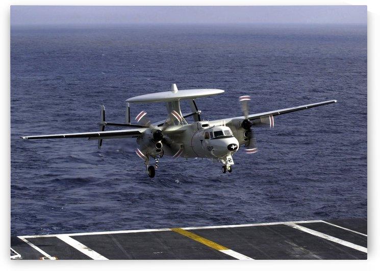An E-2C Hawkeye approaches the flight deck aboard USS Nimitz. by StocktrekImages