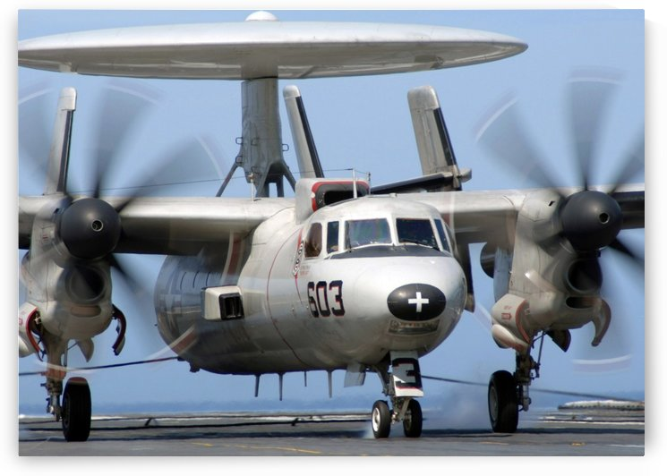An E-2C Hawkeye conducts an arrested landing. by StocktrekImages