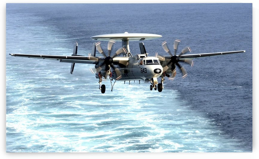 An E-2C Hawkeye prepares for an arrested landing. by StocktrekImages