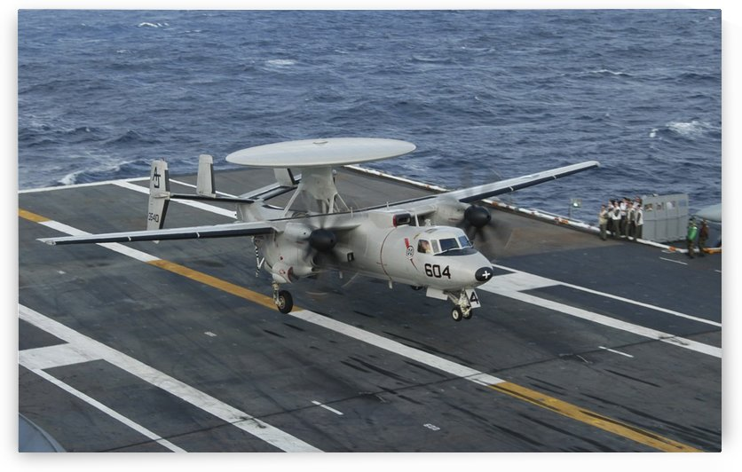 An E-2C Hawkeye is recovered during flight deck operations aboard USS Theodore Roosevelt. by StocktrekImages