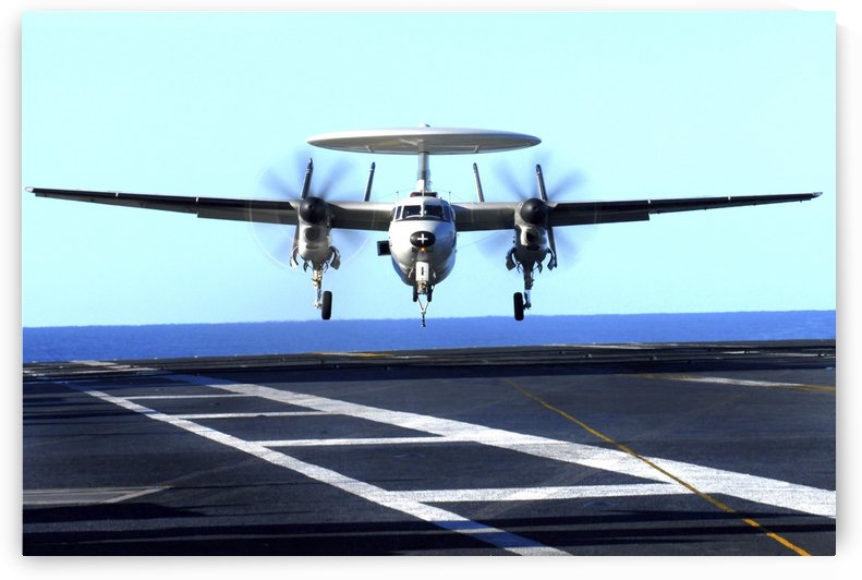 An E-2C Hawkeye approaches for landing aboard USS John C Stennis. by StocktrekImages