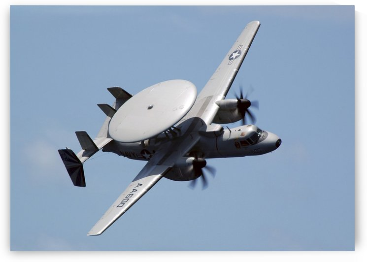 An E-2C Hawkeye executes a high performance fly-by during an Air Power Demonstration. by StocktrekImages