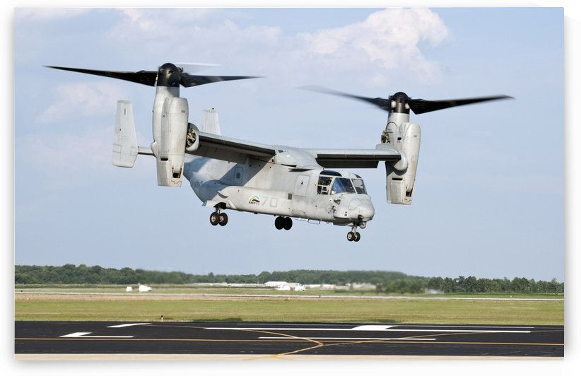 A U.S. Marine Corps MV-22 Osprey lifts off during a successful biofuel test flight. by StocktrekImages
