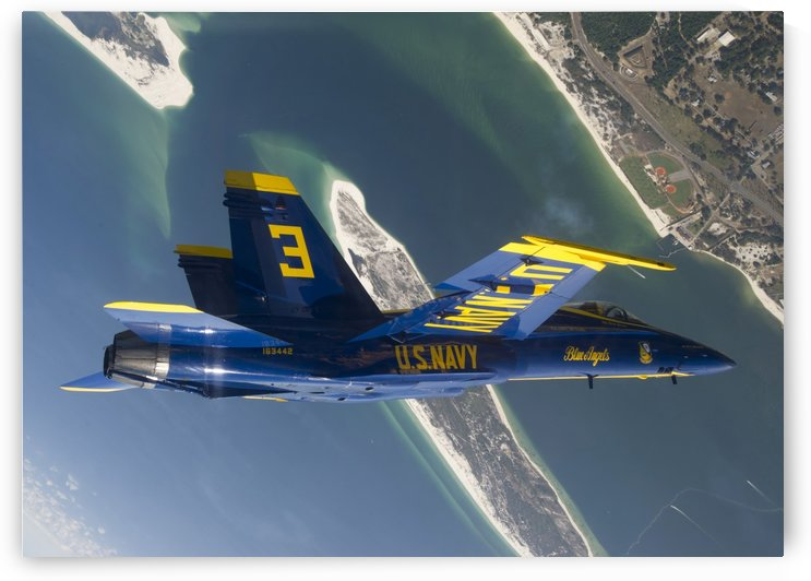 The Blue Angels perform a looping maneuver over Naval Air Station Pensacola. by StocktrekImages