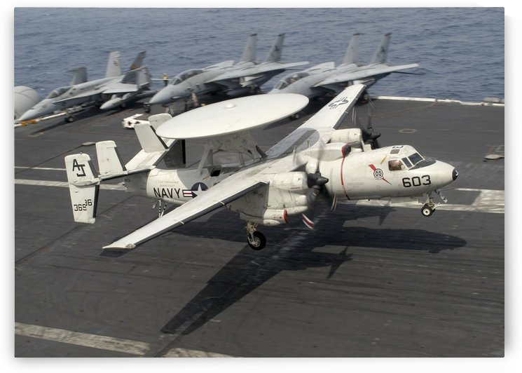 An E-2C Hawkeye lands on the flight deck of USS Theodore Roosevelt. by StocktrekImages