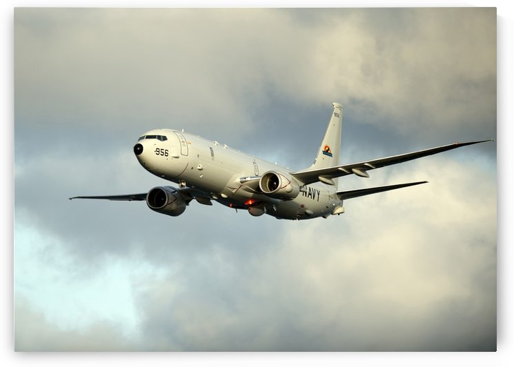 A P-8A Poseidon in flight. by StocktrekImages