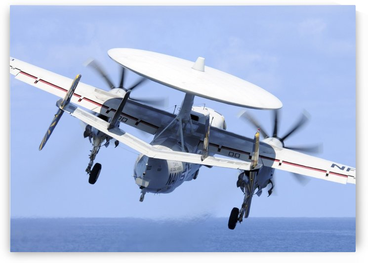 An E-2C Hawkeye launches from the aircraft carrier USS George Washington. by StocktrekImages