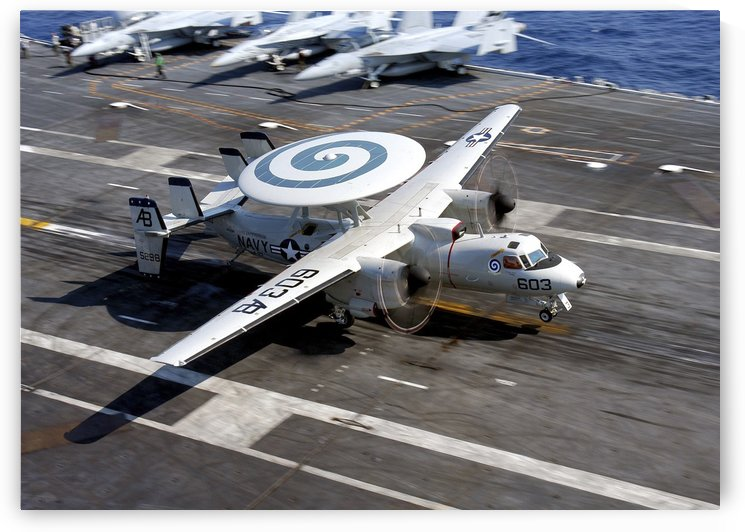 An E-2C Hawkeye lands on the flight deck of USS Enterprise. by StocktrekImages
