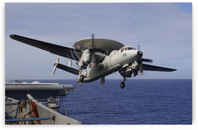 An E-2C Hawkeye launches from USS Kitty Hawk. by StocktrekImages