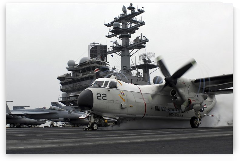 A C-2A Greyhound launches from the aircraft carrier USS Ronald Reagan. by StocktrekImages