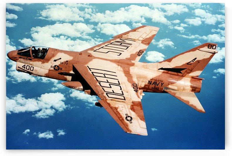 An A-7 Corsair II in flight during Operation Desert Storm. by StocktrekImages