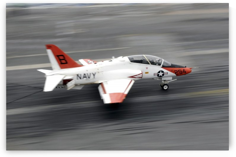 A T-45C Goshawk training aircraft makes an arrested landing. by StocktrekImages