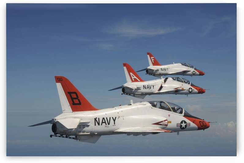 U.S. Navy T-45 Goshawk training aircraft fly in formation. by StocktrekImages
