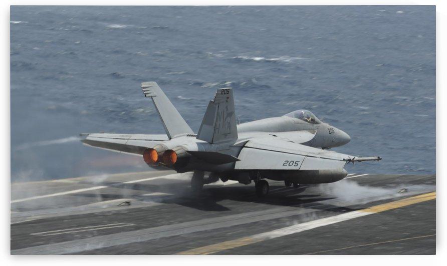 An F-A-18E Super Hornet launches off the flight deck of USS Nimitz. by StocktrekImages