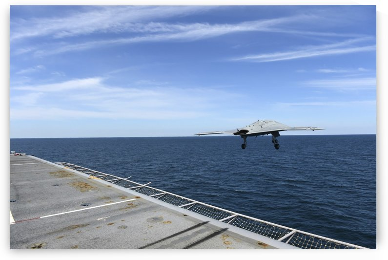 An X-47B Unmanned Combat Air System launches from USS George H.W. Bush. by StocktrekImages
