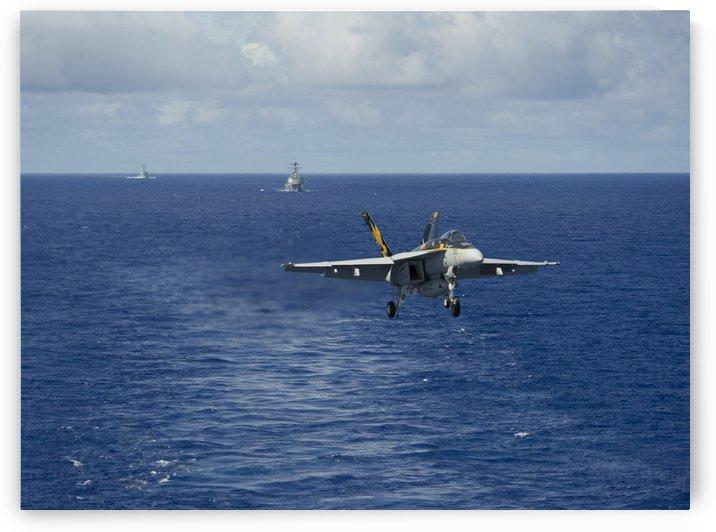 n F-A-18E Super Hornet prepares to make an arrested landing. by StocktrekImages