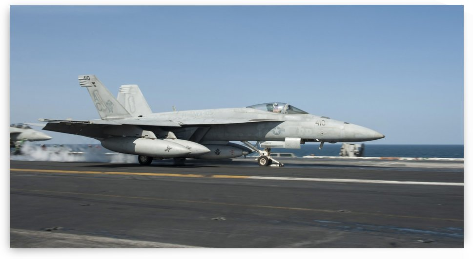 An F-A-18E Super Hornet launches from the flight deck of USS Harry S. Truman. by StocktrekImages