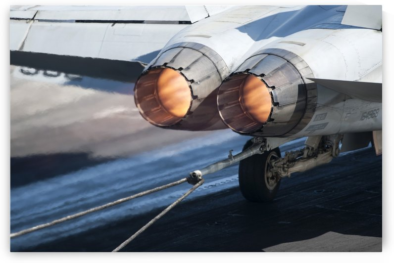 An F-A-18C Hornet catches an arresting gear wire. by StocktrekImages