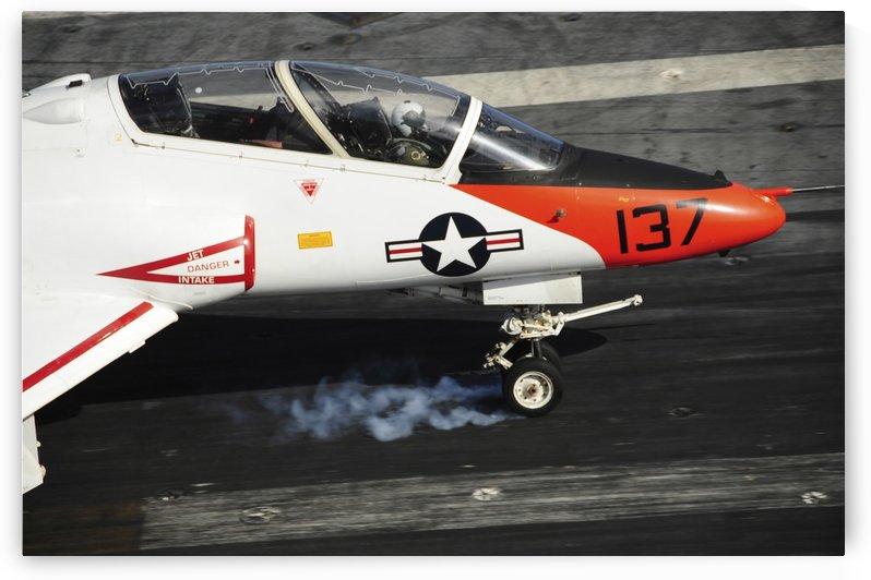 A T-45C Goshawk lands on the flight deck of USS Theodore Roosevelt. by StocktrekImages