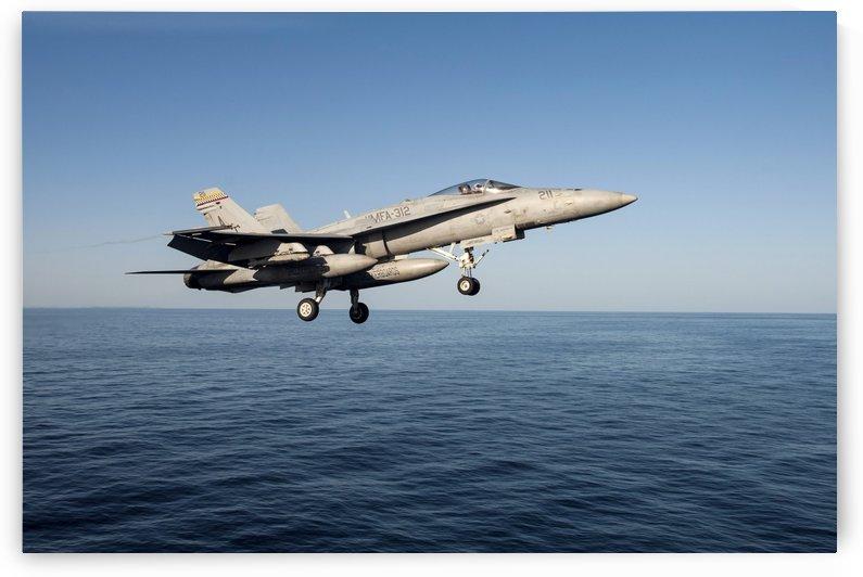 An F-A-18C Hornet flies above the Gulf of Oman. by StocktrekImages