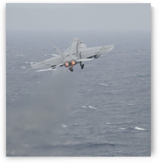 An F-A-18E Super Hornet launches off the flight deck of USS Nimitz. by StocktrekImages