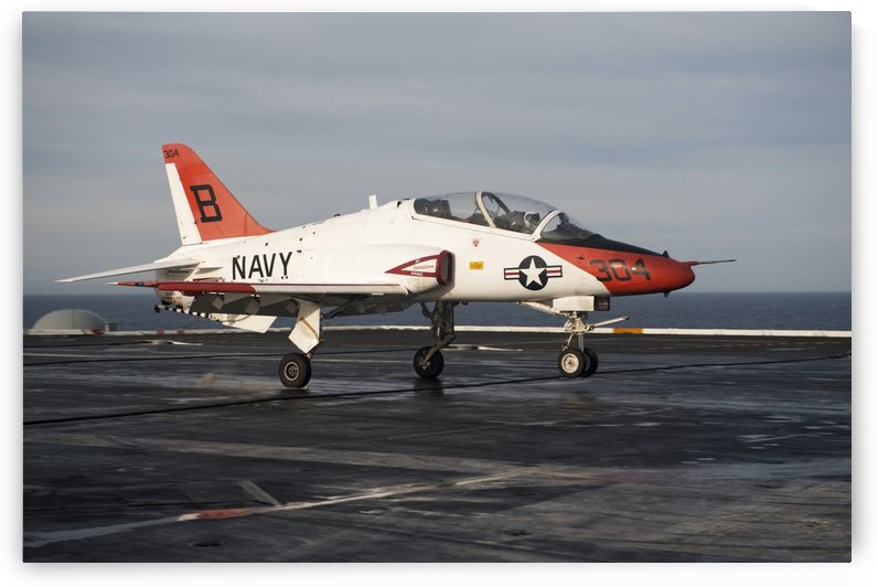 A T-45C Goshawk lands on the flight deck of USS Carl Vinson. by StocktrekImages