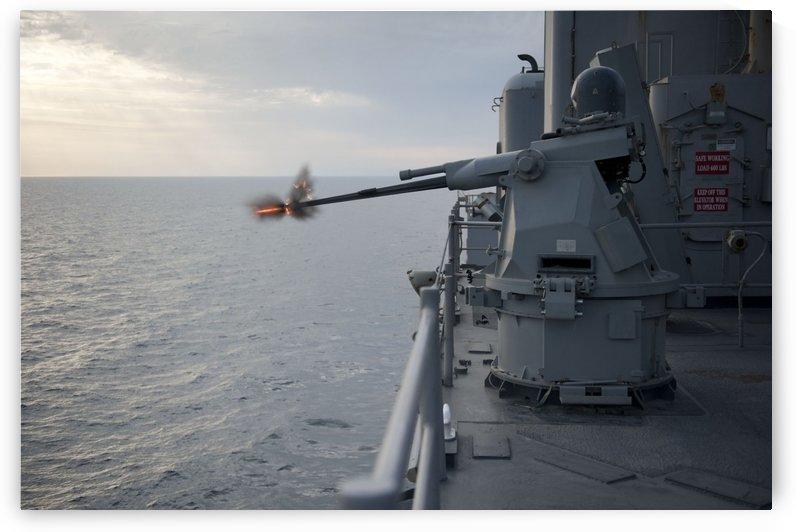An MK38 MOD 2 25mm machine gun system aboard USS Pearl Harbor. by StocktrekImages
