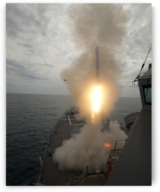 A tomahawk missile launch aboard USS Preble. by StocktrekImages