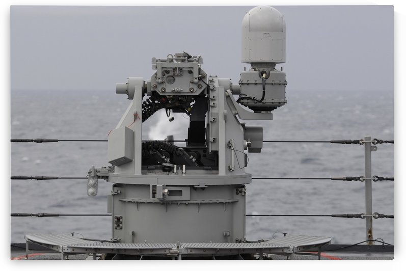 A 25mm machine gun is fired aboard USS Blue Ridge. by StocktrekImages