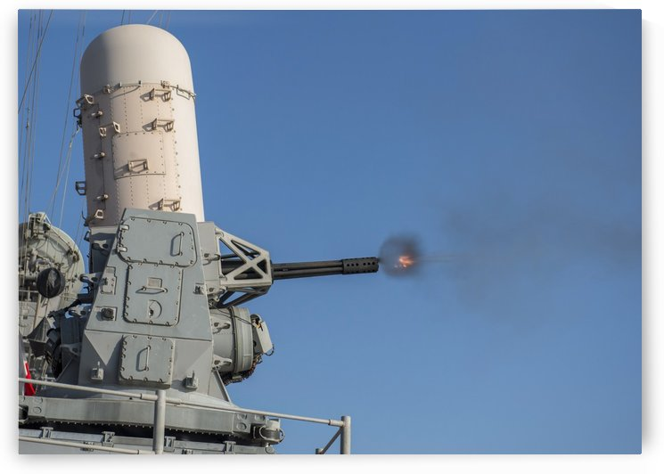 USS San Jacinto fires a close-in weapons system during a live-fire exercise. by StocktrekImages