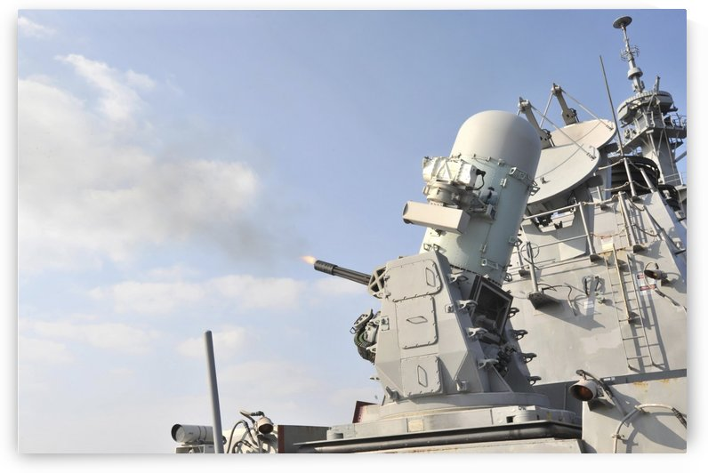 A phalanx close-in weapons system is fired aboard USS Lassen. by StocktrekImages