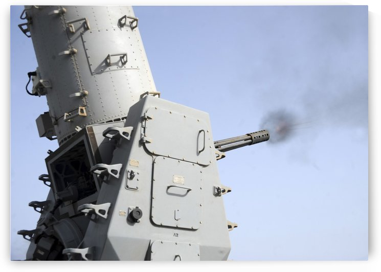 A close-in weapons system fires during an operational test aboard USS Vicksburg. by StocktrekImages
