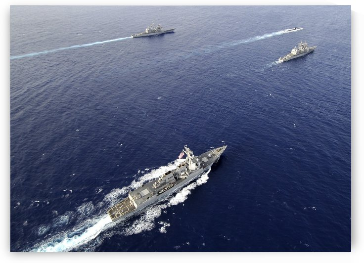 Aerial view of a naval fleet transiting the Pacific Ocean. by StocktrekImages