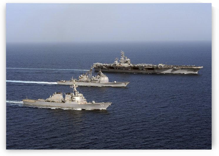 Three U.S. Navy ships sail in formation in the Arabian Sea. by StocktrekImages