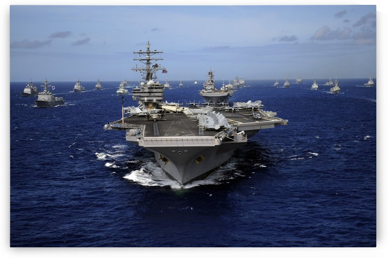Aircraft carrier USS Ronald Reagan leads a mass formation of ships through the Pacific Ocean. by StocktrekImages