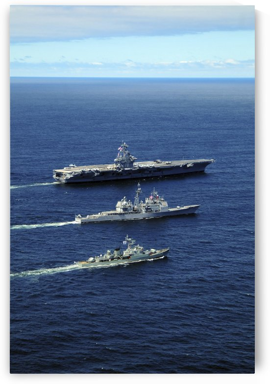 U.S. Navy ships perform tactical maneuvering exercises in the Atlantic Ocean. by StocktrekImages