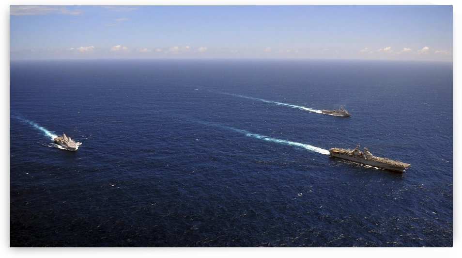 USS Boxer USS Comstock and USS Green Bay transit the Indian Ocean. by StocktrekImages