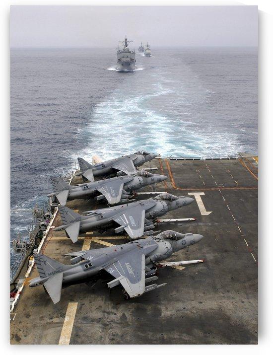 AV-8B Harriers line the flight deck of amphibious assault ship USS Tarawa. by StocktrekImages