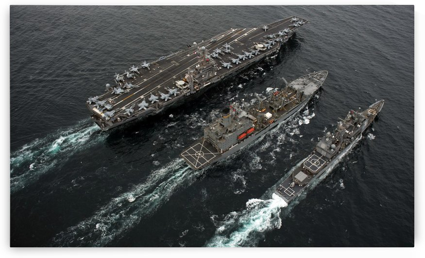 A replenishment at sea between USS Abraham Lincoln USNS Guadalupe and USS Cape St. George. by StocktrekImages