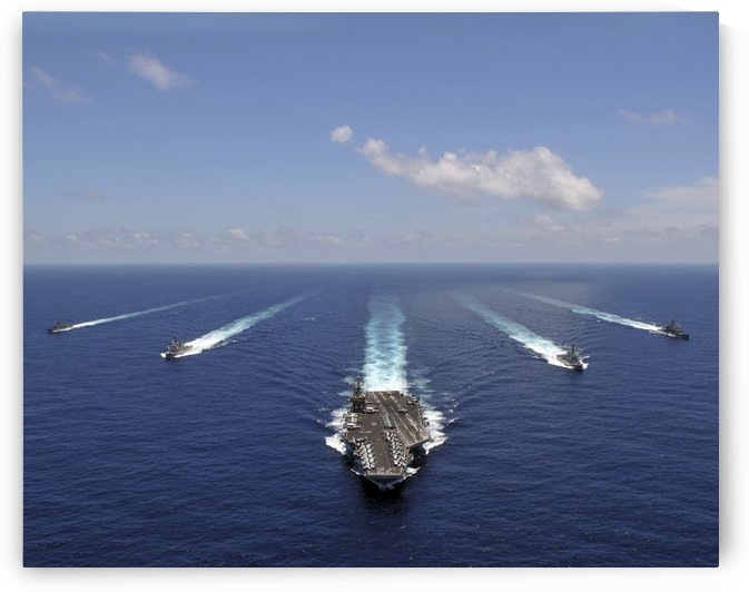 The aircraft carrier USS Abraham Lincoln leading a formation of ships from the Abraham Lincoln Strike Group.  by StocktrekImages