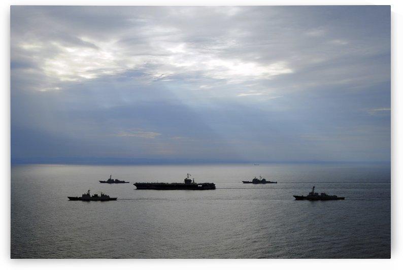 A fleet of multinational Navy ships transit the Korea Strait. by StocktrekImages