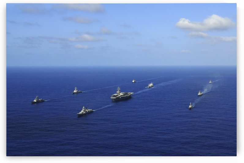 Ships from the Ronald Reagan Carrier Strike Group transit the Pacific Ocean. by StocktrekImages